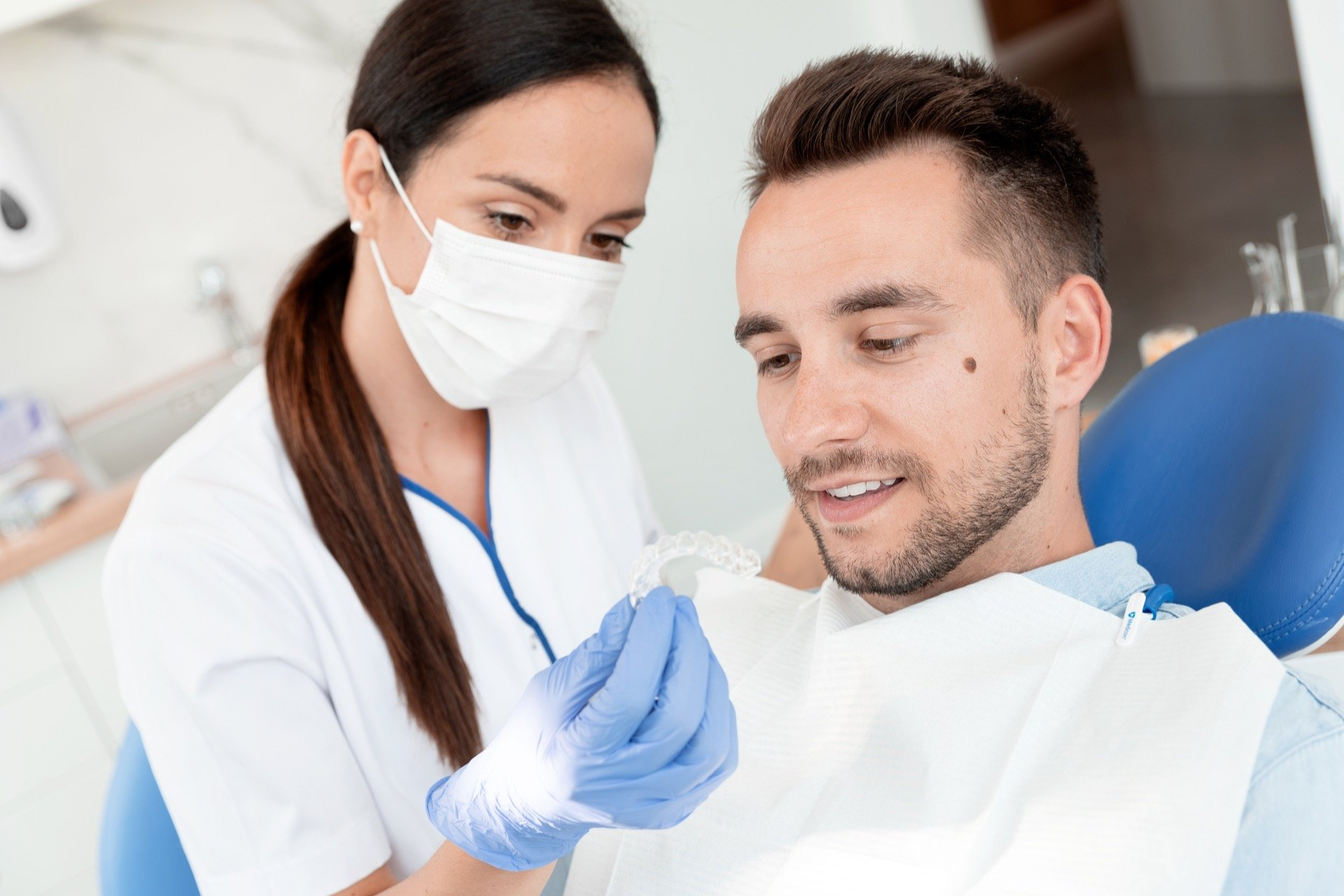 Orthodontist showing benefits of Invisalign to patient